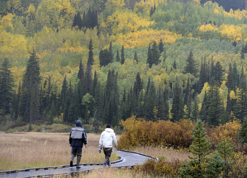 Al Hartmann  |  The Salt Lake Tribune Fishermen walk the boardwalk in a cold rain to Silver Lake in Big Cottonwood Canyon Sunday September 21.