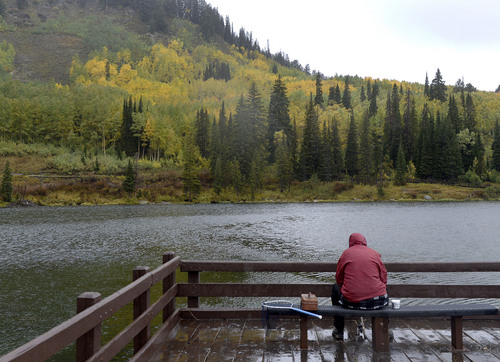 Al Hartmann  |  The Salt Lake Tribune Fisherman braves a cold rain Sunday September 21 at Silver Lake in Big Cottonwood Canyon.  Fishing was slow but the fall colors made up for it.