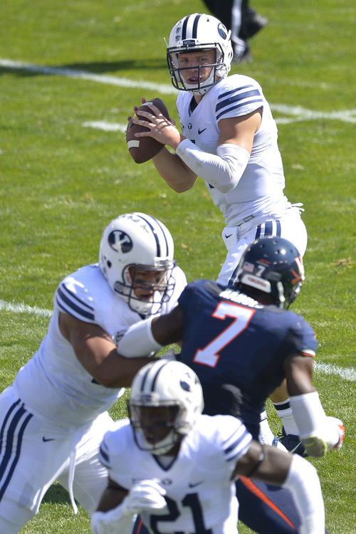 Chris Detrick  |  The Salt Lake Tribune Brigham Young Cougars quarterback Taysom Hill (4) looks to pass the ball during the game at LaVell Edwards Stadium Saturday September 20, 2014.  Virginia is winning the game 16-13 at halftime.