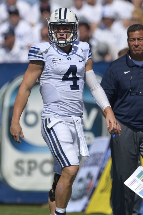 Chris Detrick  |  The Salt Lake Tribune Brigham Young Cougars quarterback Taysom Hill (4) during the game at LaVell Edwards Stadium Saturday September 20, 2014.  Virginia is winning the game 16-13 at halftime.