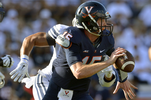 Chris Detrick  |  The Salt Lake Tribune Virginia Cavaliers quarterback Matt Johns (15) looks to pass the ball during the second half of the game at LaVell Edwards Stadium Saturday September 20, 2014.  BYU won the game 41-33.