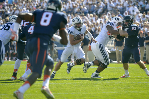 Chris Detrick  |  The Salt Lake Tribune Brigham Young Cougars quarterback Taysom Hill (4) runs the ball during the second half of the game at LaVell Edwards Stadium Saturday September 20, 2014.  BYU won the game 41-33.