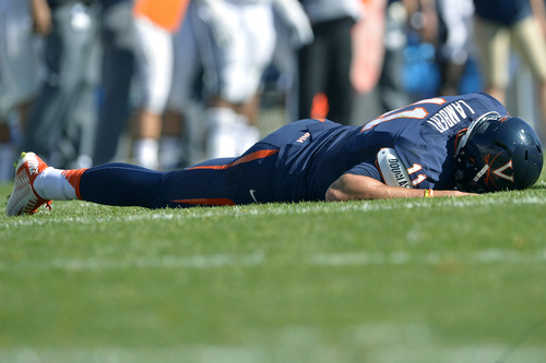 Chris Detrick  |  The Salt Lake Tribune Virginia Cavaliers quarterback Greyson Lambert (11) remains on the ground during the second half of the game at LaVell Edwards Stadium Saturday September 20, 2014.  BYU won the game 41-33.