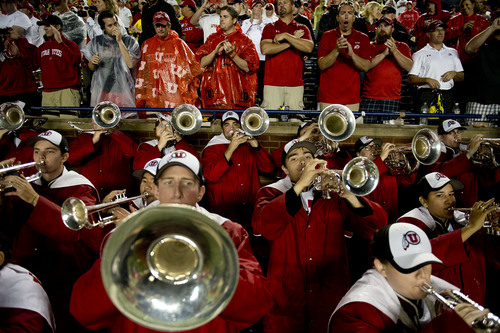 Jeremy Harmon  |  The Salt Lake Tribune  The Utah marching band plays at the end of a two-hour-twenty-four-minus delay as the Utes face the Wolverines in Ann Arbor, Saturday, Sept. 20, 2014.