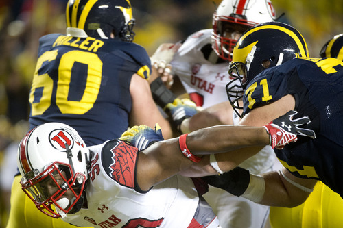 Jeremy Harmon  |  The Salt Lake Tribune  Utah Utes linebacker Pita Taumoepenu (50)breaks through Michigan's offensive line as the Utes face the Wolverines in Ann Arbor, Saturday, Sept. 20, 2014.