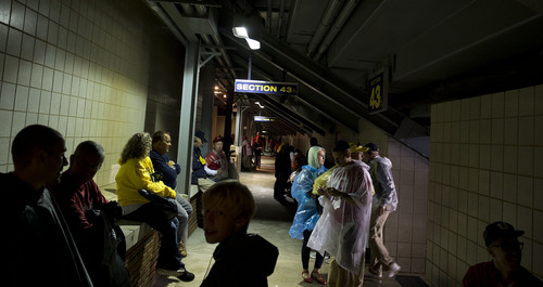 Jeremy Harmon  |  The Salt Lake Tribune  Fans wait out a rain delay as the Utes face the Wolverines in Ann Arbor, Saturday, Sept. 20, 2014.