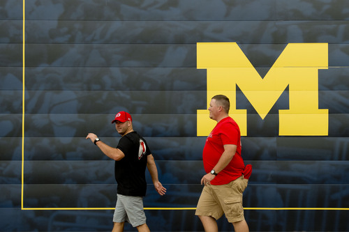 Jeremy Harmon  |  The Salt Lake Tribune  Utah fans arrive at Michigan Stadium before the Utes face the Wolverines in Ann Arbor, Saturday, Sept. 20, 2014.