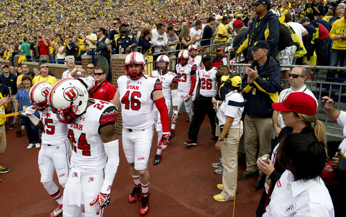 Jeremy Harmon  |  The Salt Lake Tribune  Utah enters Michigan Stadium as the Utes face the Wolverines in Ann Arbor, Saturday, Sept. 20, 2014.