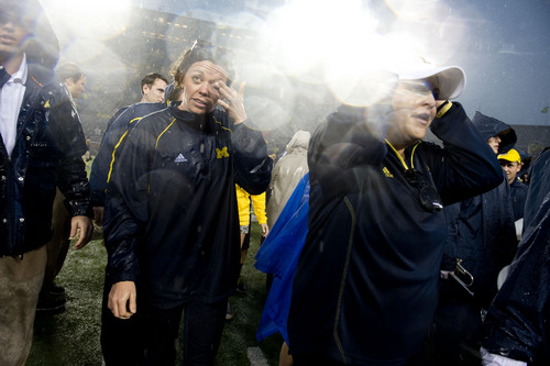 Jeremy Harmon  |  The Salt Lake Tribune  Michigan fans leave the stadium after the game was suspended due to bad weather as the Utes face the Wolverines in Ann Arbor, Saturday, Sept. 20, 2014.