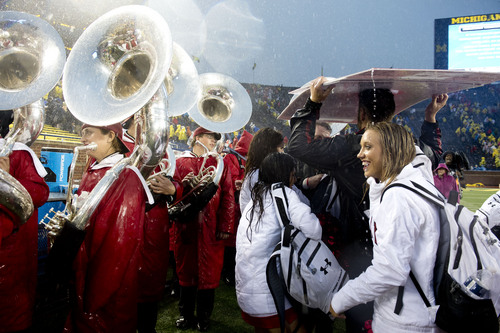 Jeremy Harmon  |  The Salt Lake Tribune  Utah band members and cheerleaders and the band wait to leave the stadium after the game was suspended due to bad weather as the Utes face the Wolverines in Ann Arbor, Saturday, Sept. 20, 2014.