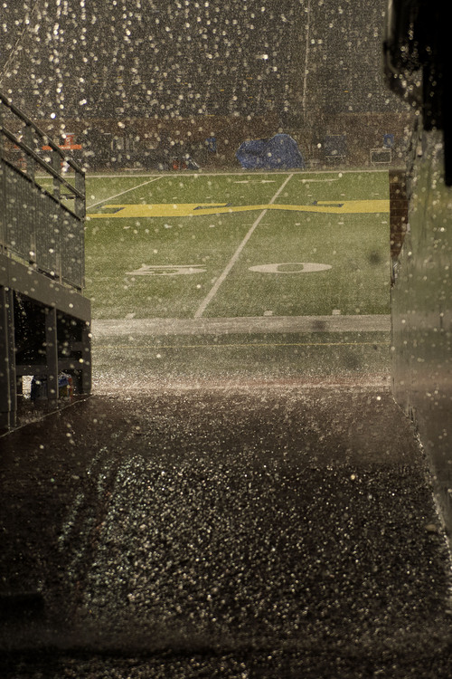 Jeremy Harmon  |  The Salt Lake Tribune  Heavy rain falls in Ann Arbor during a delay in the game between Utah and Michigan, Saturday, Sept. 20, 2014.