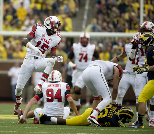 Jeremy Harmon  |  The Salt Lake Tribune  Utah Utes wide receiver Dominique Hatfield (15) celebrates a play as the Utes face the Wolverines in Ann Arbor, Saturday, Sept. 20, 2014.