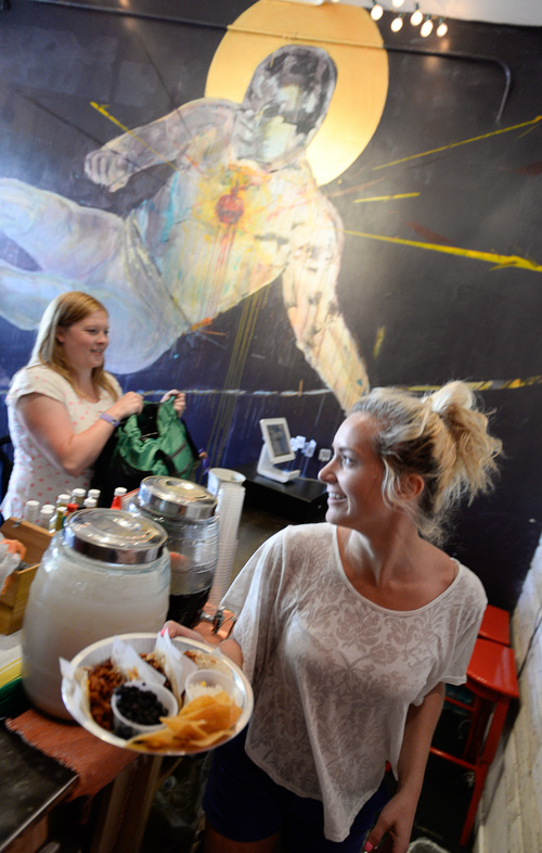 Francisco Kjolseth  |  The Salt Lake Tribune Tess Harper serves up an order at Taco Taco, a new place by the same owners of Cannella's. The tiny spot at 208 E. 500 South in Salt Lake has been popular with the lunch crowd.