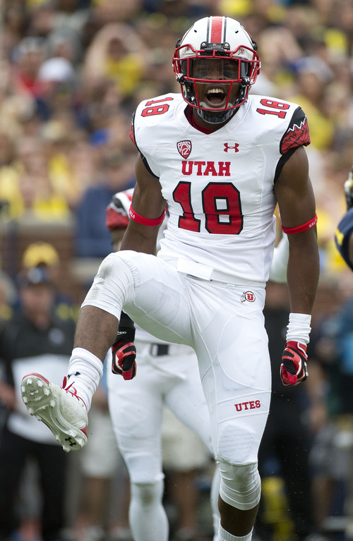 Jeremy Harmon  |  The Salt Lake Tribune  Utah's Eric Rowe (18) celebrates a tackle as the Utes face the Wolverines in Ann Arbor, Saturday, Sept. 20, 2014.