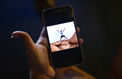 Scott Sommerdorf   |  The Salt Lake Tribune Rajiv Panchal is seen on the cellphone of his wife Anjali during a recent trip to Goblin Valley. The Panchals were brought from India to help Kunal Sah manage the Green River Ramada Inn, Wednesday, September 16, 2014.