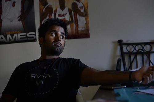 Scott Sommerdorf   |  The Salt Lake Tribune Kunal Sah in his living room at the Ramada Inn he manages, Wednesday, September 16, 2014.
