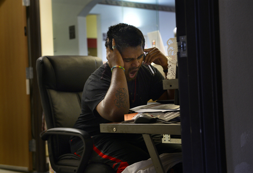 Scott Sommerdorf   |  The Salt Lake Tribune Kunal Sah yawns deeply as he takes a call from a guest after he had to wake up earlier than he had planned in order to help with a heavy demand from guests, Thursday, September 17, 2014.