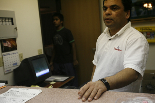 """Kunal Sah's uncle D.C. Prasad works the front desk of the Ramada Wednesday December 17, 2008.   His parents Kanhai and Sarita were denied political asylum and deported back to India in 2006, so Kunal lives with his uncle and aunt at the Ramada Limited Motel.  """"Basketball is my favorite sport,"""" said Sah.  """"I love just going to practice, playing games and associating with everybody. The teammages and coaches, they are all fun to be around.""""  """"I hope I do see a day in my real life that they come back,"""" said Sah. """"But what ever is happening right now, I guess we have to deal with it.""""    Chris Detrick/The Salt Lake Tribune"""