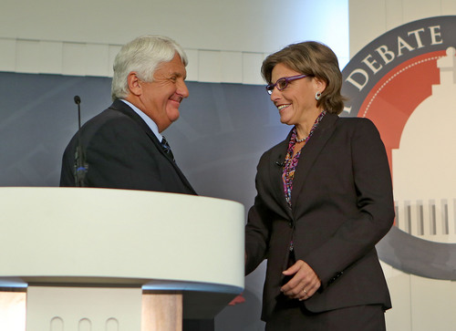 Tom Smart  |  Pool  Republican Congressman Rob Bishop and Democratic challenger Donna McAleer shake hands before the debate in the Utah Debate Commission's 1st Congressional District debate at Weber State University Tuesday, Sept. 23, 2014, in Ogden.