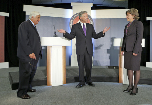 Moderator Ken Verdoia welcomes Republican Congressman Rob Bishop and Democratic challenger Donna McAleer  before the coin toss  in the debate in the Utah Debate Commission's 1st Congressional District debate at Weber State University Tuesday, Sept. 23, 2014, in Ogden.