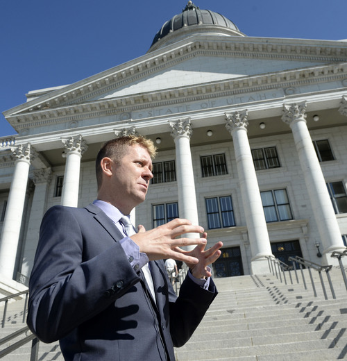 "Al Hartmann  |  The Salt Lake Tribune LGBT protestor Troy Williams, one of the ""Capitol 13"" who were arrested for disturbing the Legislature in February, speaks in front of the Utah Capitol building after a press conference Aug. 28. Williams will be the new leader of Equality Utah, a gay rights group."