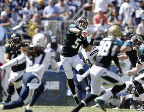Jacksonville Jaguars quarterback Blake Bortles fires a ass over the San Diego Chargers defense during the first quarter of an NFL football game Sunday, Sept. 28, 2014, in San Diego.  (AP Photo/Gregory Bull)