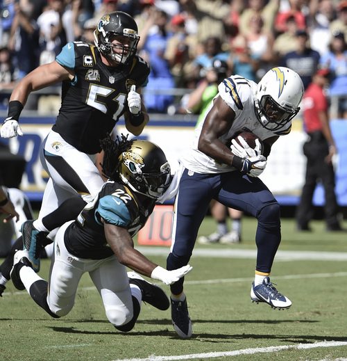 San Diego Chargers wide receiver Eddie Royal gets to the end zone with a 43 yard touchdown reception against the Jacksonville Jaguars during the first half of an NFL football game Sunday, Sept. 28, 2014, in San Diego. (AP Photo/Denis Poroy)