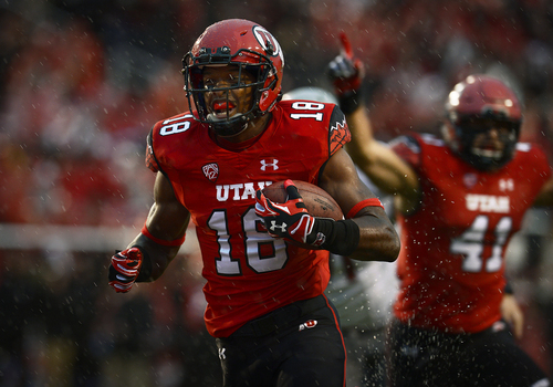 Scott Sommerdorf   |  The Salt Lake Tribune As Utah LB Jared Norris celebrates at right, DB Eric Rowe crosses the goal line with an INT to give Utah a very quick 7-0 lead. Utah took a 21-0 lead over Washington State in the first quarter, Saturday, September 27, 2014.