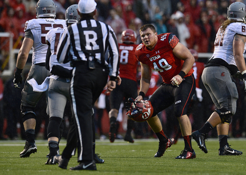 Scott Sommerdorf   |  The Salt Lake Tribune Utah DE Hunter Dimick reacts after his helmet was pulled off by a Washington State lineman. The Cougars were called for an illegal hands to the face penalty on the play. Utah took a quick 21-0 lead over Washington State in t he first quarter, Saturday, September 27, 2014.