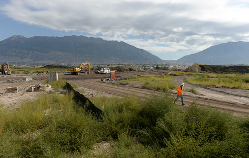 Francisco Kjolseth  |  The Salt Lake Tribune UDOT crews began work in July on a one-mile segment of the Vineyard Connector, tying Orem's 800 North and I-15 with the @geneva project, a 1,700 acre master-planned community project being built on the site of the old Geneva Steel Mill, at Vineyard in Utah County.