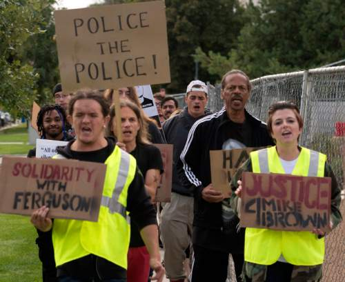 Rick Egan  |  The Salt Lake Tribune  Protesters march in downtown Salt Lake City, in solidarity with Mike Brown, Dillon Taylor, Danielle Willard and others who they feel were killed unjustly by police. Monday, August 25, 2014.