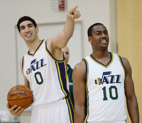 Steve Griffin  |  The Salt Lake Tribune   Enes Kanter and Alec Burks laugh as they hang out during Jazz Media Day at the Zions Bank Basketball Center in Salt Lake City, Monday, September 29, 2014.