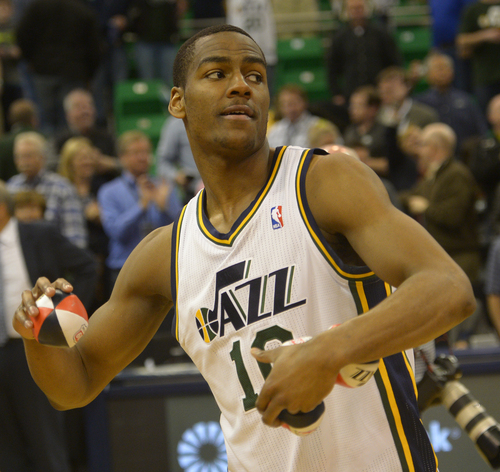 Rick Egan  |  The Salt Lake Tribune  Utah Jazz guard Alec Burks (10) tosses autographed basketballs in to the crowd, after the last home game of the season, at EnergySolutions Arena, Monday, April 14, 2014