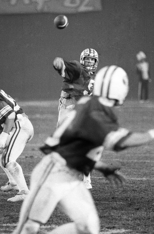 Brigham Young University quarterback Jim McMahon is shown during his team's 38-36 victory over Washington State in the Holiday Bowl, Dec. 19, 1981, in San Diego.  McMahon, who threw for 342 yards and three touchdowns, was named the game's most valuable player.  (AP Photo)