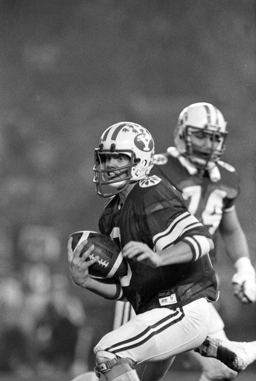 Brigham Young University quarterback Jim McMahon scrambles for yardage during his team's 38-36 victory over Washington State in the Holiday Bowl, Dec. 19, 1981, in San Diego.  McMahon, who threw for 342 yards and three touchdowns, was named the game's most valuable player.  (AP Photo)