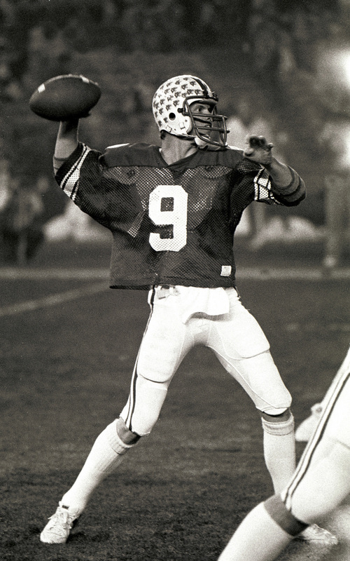 BYU quarterback Jim McMahon looks for a receiver in the 1980 Holiday Bowl against Southern Methodist University. Dec 19, 1980. Courtesy Mark Philbrick  |  BYU