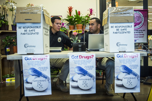 Chris Detrick  |  The Salt Lake Tribune West Valley City Detectives Scott Arnold, left, and Tony Wolfgramm collect unused prescription drugs at Smith's Food and Drug in West Valley City Saturday September 27, 2014. Utahns who wanted to get rid of unwanted, expired and unused prescription drugs could drop them off Saturday at 12 Smith's Food and Drug stores in Utah, Salt Lake and Davis counties.  Smith's is teaming with the Drug Enforcement Administration to collect the medications, no questions asked, between 10 a.m. and 2 p.m.