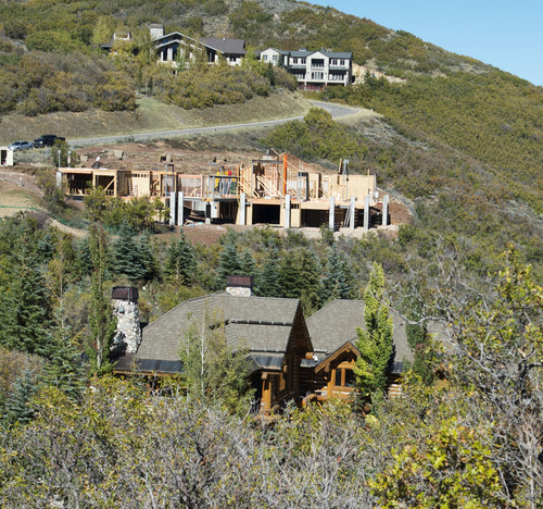 Steve Griffin  |  The Salt Lake Tribune  Mitt Romney has registered to vote in Summit County as unaffiliated and is using his old address as his residence at this home, bottom, in Park City, Utah. The home was photographed Thursday, October 2, 2014.