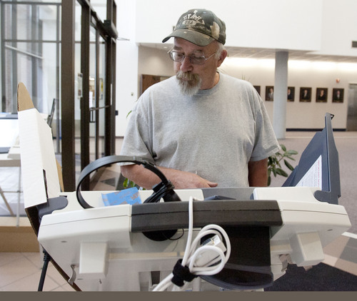 Steve Griffin     Tribune file photo West Valley City resident Richard Anderton votes early at West Valley City Hall in last year's municipal election.