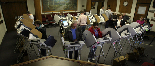 Steve Griffin   Tribune file photo Salt Lake County residents take advantage of early voting as they cast their ballots at Murray City Hall in the 2012 general election.