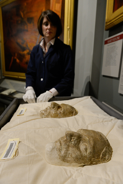 Francisco Kjolseth  |  The Salt Lake Tribune Carrie Snow keeps watch over the death masks of Joseph Smith and Hyrum Smith as the LDS Church History Museum prepares to close on Oct. 6, for renovations over the next year. When it reopens before next fall's General Conference, it will include a broader message about Jesus Christ along with more details and stories and artifacts from their collections that have not been on display.