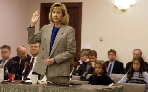 Jill Parrish, nominee for Utah State Court raises hand and is sworn in before being questioned by the  Senate confirmation committe Wed night.    Hartmann/photo  2/12/03
