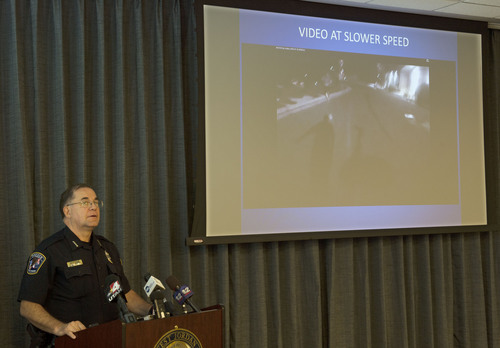 """Steve Griffin     The Salt Lake Tribune   West Jordan Police Chief Doug Diamond narrates the body camera video of an officer-involved shooting of Timothy Peterson on July 10, 2014 during a press conference at the West Jordan Justice Center in West Jordan, Utah Friday, October 3, 2014. Peterson was shot and wounded by police after pointing a metal bar, bent in the shape of a handgun, that had a laser pointer taped to the """"barrel."""""""
