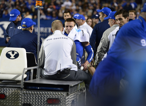 Scott Sommerdorf     The Salt Lake Tribune BYU QB Taysom Hill is taken off the field on a cart after being injured on a run late in the second quarter. Utah State led BYU 28-14 at the half in Provo, Friday, October 1, 2014.