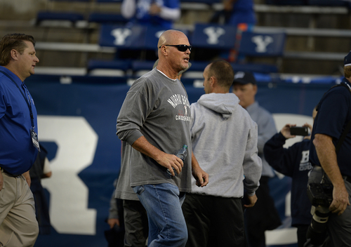 Scott Sommerdorf     The Salt Lake Tribune Former BYU QB and NFL QB Jim McMahon arrives on the field during pre game warmups before BYU plays Utah State in Provo, Friday, October 1, 2014. He will be honored at halftime.