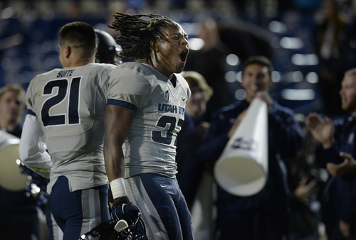 Scott Sommerdorf     The Salt Lake Tribune Utah State Aggies safety Devin Centers (37) celebrates after the game ended and USU had beaten BYU. Utah State defeated BYU 35-20 in Provo, Friday, October 1, 2014.