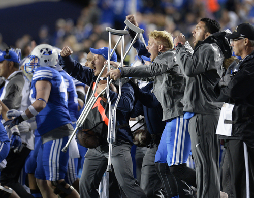 Scott Sommerdorf     The Salt Lake Tribune Injured BYU DB Dallin Leavitt celebrates what the bench thought was a recovered on-side kick, but the ball was ruled to have been recovered by USU late in the game. Utah State defeated BYU 35-20 in Provo, Friday, October 1, 2014.