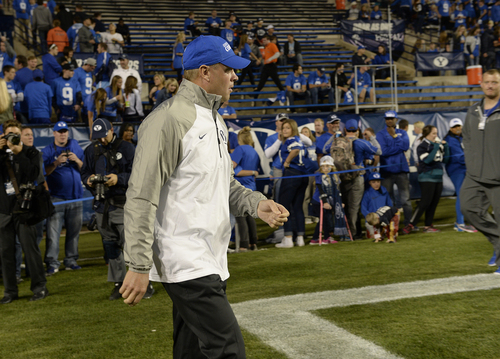 Scott Sommerdorf     The Salt Lake Tribune BYU head coach Bronco Mendenhall walked onto the field during pre game warmups before BYU plays Utah State in Provo, Friday, October 1, 2014.