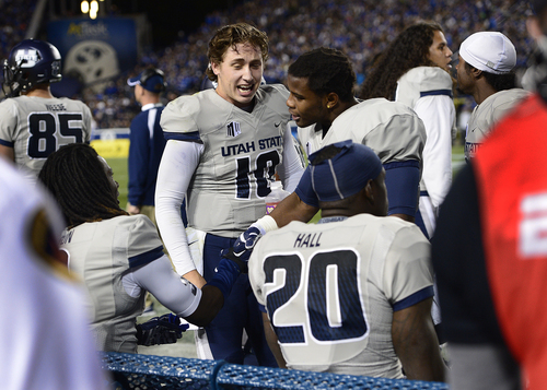 Scott Sommerdorf     The Salt Lake Tribune Utah State Aggies quarterback Darell Garretson celebrates with teammates after a USU TD during first half play. Utah State led BYU 28-14 at the half in Provo, Friday, October 1, 2014.