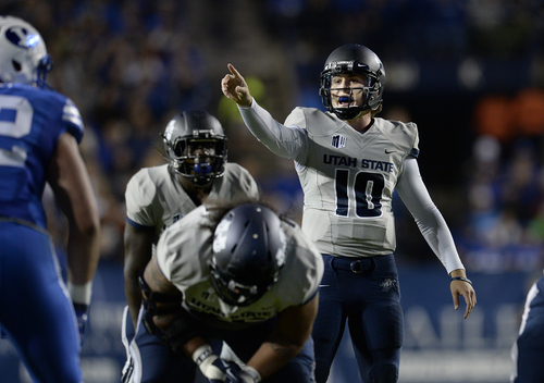 Scott Sommerdorf     The Salt Lake Tribune Utah State Aggies quarterback Darell Garretson (10) shouts directions to his offensive line during first half play. Utah State led BYU 28-14 at the half in Provo, Friday, October 1, 2014.